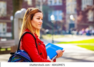 A young female college student between classes.