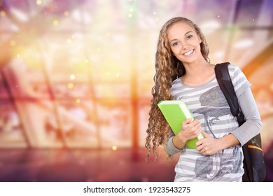 Young female college student on library background