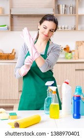 Young female contractor doing housework