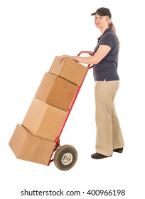 Young female delivery person isolated on white with boxes and hand truck