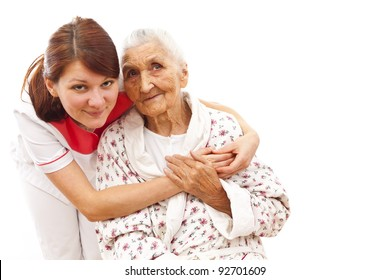 Young female doctor  caring about a very old female patient