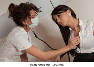 Young female doctor examining sexy patient