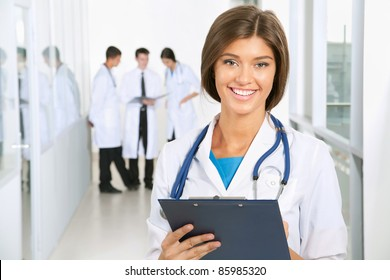 Young female doctor and her colleagues