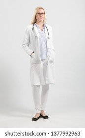 young female doctor in lab coat with stethoscope is looking friendly