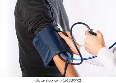 young female doctor measures the blood pressure to a man