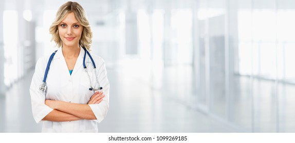 Young female doctor on modern clinic background. Horizontal image for website design.