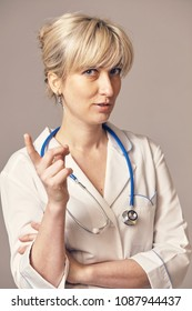 a young female doctor pointing his finger at something
