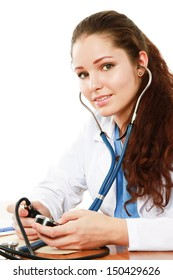 Young female doctor sitting on the desk with stethoscope isolated on white background