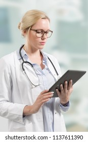 young female doctor with stethoscope and clipboard
