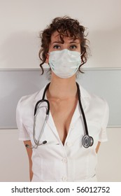 Young female doctor wearing surgical mask and stethoscope