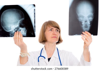 young female doctor with X-ray photograph in front of white background