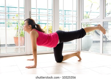 Young female doing her leg stretch as part of fitness and healthy living