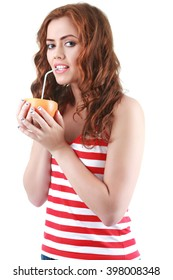 Young female drinking grapefruit juice, on white background