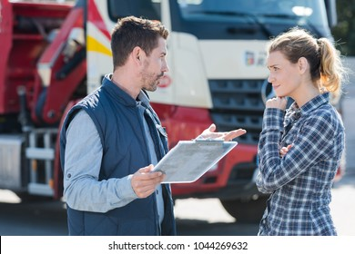 young female driver talking to boss outdoors