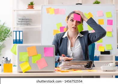 Young female employee in conflicting priorities concept