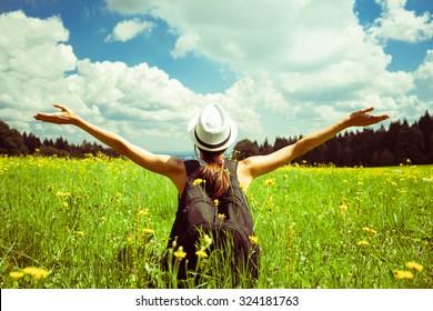 Young female enjoying the beautiful outdoors.