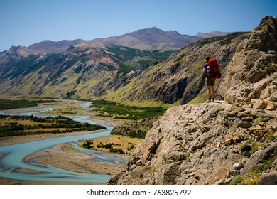 Young female is enjoying the magnificent view over Rio De Las Vueltas in Los Glaciares National Park in Patagonia, Argentina
