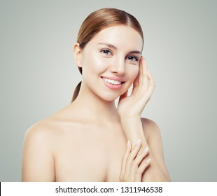 Young female face with healthy skin. Facial treatment, skincare and cosmetology concept.
