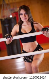 Young Female fighter enters boxing ring