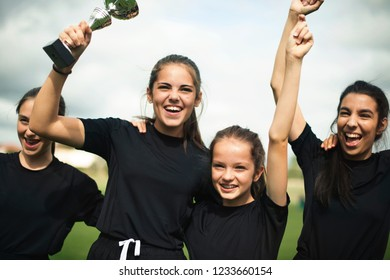 Young female football players celebrating their victory