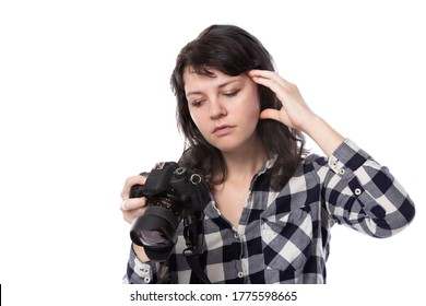 Young female freelance professional photographer or art student or photojournalist on a white background holding a camera. She is feeling sick or unwell