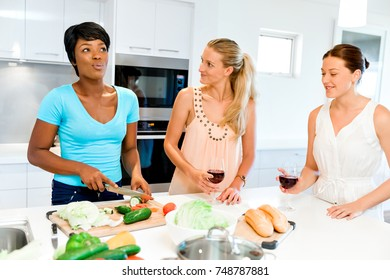 Young female friends in kitchen