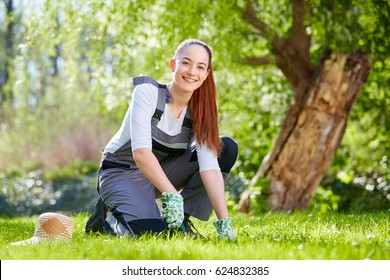 Young female gardener working in the garden