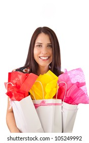 young female girl holding gift bags in her arms, isolated on white