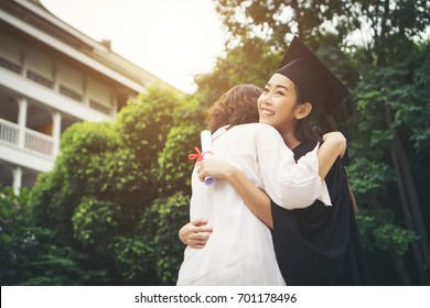 Young female graduate hugging her mother at graduation ceremony, Success,Goal. Education concept.