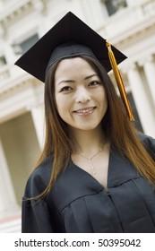 Young female Graduate outside university, portrait