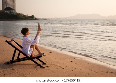 Young female gymnast on the beach