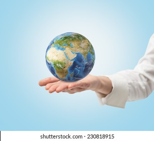 Young female hand holding a globe. frica and Asia view. Elements of this image furnished by NASA