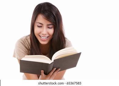 Young female happily reading book, isolated on white