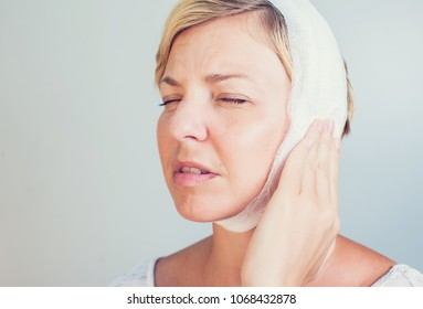 young female having ear pain touching her painful head earache