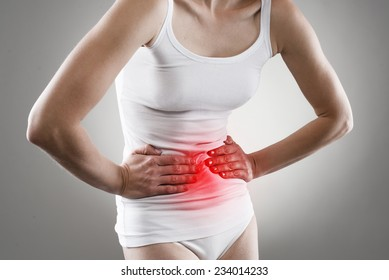 Young female having stomachache. Chronic gastritis. Ulcer. Abdomen bloating concept.