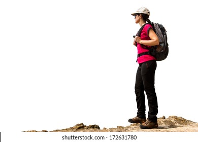Young female hiker with backpack and boots standing on rock.Isolated on white background.