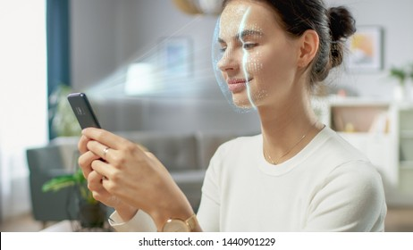 Young Female Identified by Biometric Facial Recognition Scanning Process from Her Smartphone. Futuristic Concept: Projector Identifies Individual by Illuminating Face by Dots and Scanning with Laser
