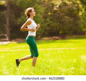 Young female jogging at the park.