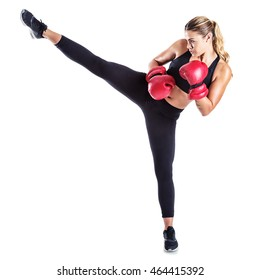 Young female kick boxer isolated on white