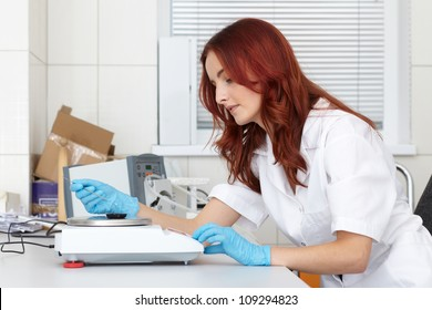 Young female lab technician works on some samples, lab shoot