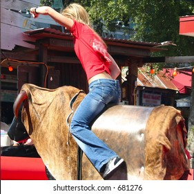 young female mechanical bull rider