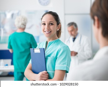 Young female medical student working at the hospital and medical staff, she is holding medical records