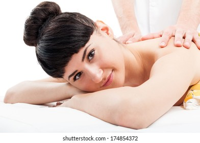 Young female model beeing very relaxed on the massage table.