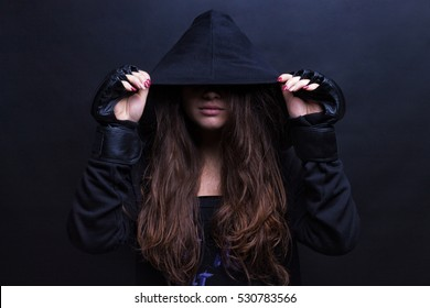 Young female model wearing sports hooded sweatshirt. Black background