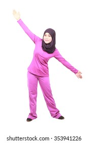 Young female muslim doing exercise with white background