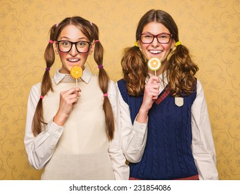 Young female nerds with lollipop