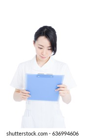 Young female nurse holding medical record, isolated on white background
