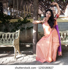 Young female Odissi artist as Sita strikes a classical pose during 'Lord of Lanka' pre-photoshoot event on December 2,2018 at Sai baba temple,Bengaluru,India