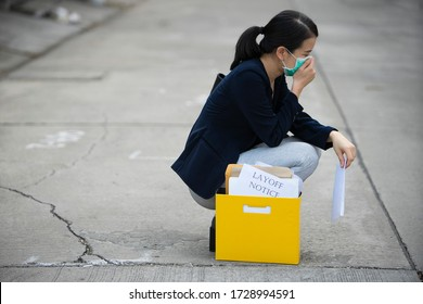 young female officeworker look stressful because her company was Layoffs or wage cuts after Covid-19(Coronavirus) Spread