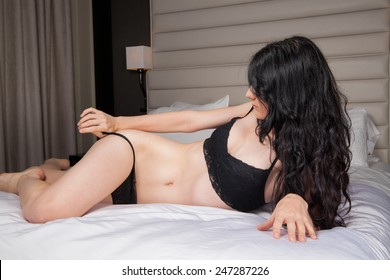 young female on a bed in lingerie